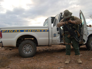 A Pinal County deputy gears up to enter the Vekol Valley. Deputies must arm themselves with...