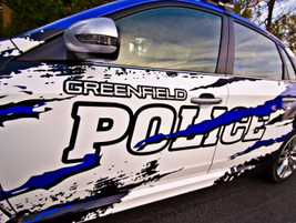 """A full vinyl wrap depicts a """"peeled paint"""" image, suggesting the vehicle's blue color was blown..."""