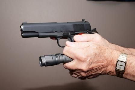 Rogers/SureFire—Created for small, very bright flashlights. The handgun is held in the standard...