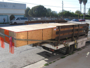 A stake-bed truck creates an unsafe situation when transporting an oversized load.