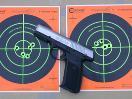 Reviewer Scarlata tested the pistol at 15, 10 and 5 yards.