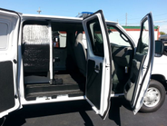 This view of the passenger side with three doors open shows access into passenger compartment...