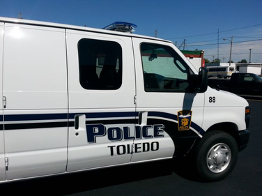 Ford's E-250 van allows Toledo Police officers to arrest groups of disorderly people and...