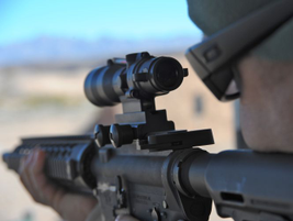 Trijicon's ACOG (Advanced Combat Optical Gunsight) 3x30 optic with a 300 AAC Blackout reticle...