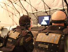 San Francisco Sheriff's Department deputies receive a video briefing, prior to attempting...