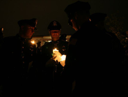 Officers and survivor families lighted each other's candles to symbolize the bond of losing an...