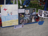 A child's drawing of happier times and photos of an officer's family are among the items left at...