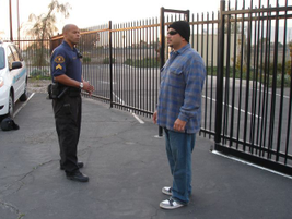 Position yourself so you're standing in the suspect's blind spot. This allows you to have a...