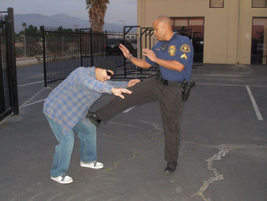 Defending With Legs: Use your leg as a front foot push. Target the suspect's pelvic region,...
