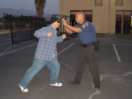 Defending With Arms: Pushing with both arms can disrupt a suspect's balance and prevent a gun...