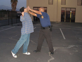 Defending With Arms: Place your hands under the suspect's chin and force the aggressor's head...