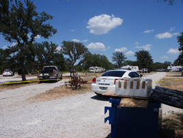 A large storage building at the entrance to the trailer park blocked Sgt. Means' view of the...