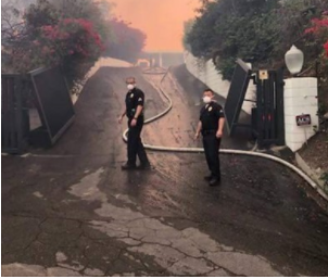 LAPD officers on the smoky streets of Bel-Air. (Photo: Sergeant Timothy Colson/LAPD)
