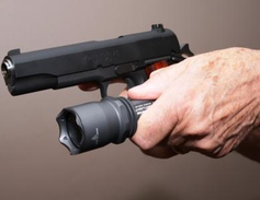 Chapman—The Chapman Technique lets you grip your handgun normally while holding light. With your...