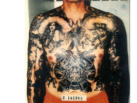 The elaborate tattoo of the Aztec calendar on this inmate is a common symbol on many Hispanic...