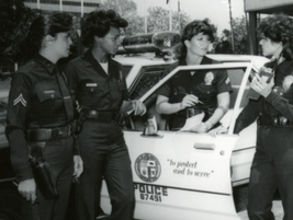 Women police officers are shown in front of Parker Center, the LAPD headquarters, during the...