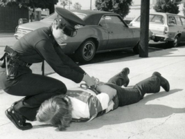 A female police officer makes an arrest in the 1980s. Photo courtesy of the Los Angeles Police...