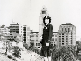 A policewoman is seen with City Hall as a backdrop in 1948. Photo courtesy of the Los Angeles...