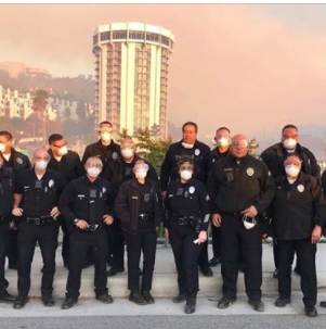 LAPD officers from the Northeast Division working the Skirball Fire wear masks to protect them...