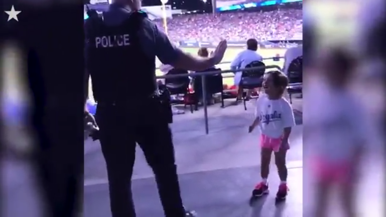 MO Officer Dances with Little Girl at Baseball Game