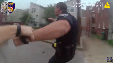 Baltimore Officer Phillip Lippe was shot twice in his vest during the gunfight.