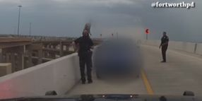 Texas Police Save Woman from Jumping off Freeway Overpass
