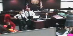Prisoner Tries Gun Grab In Court