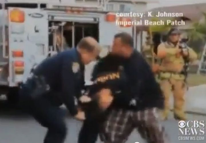 SD Cop Drags Woman Away from Fire